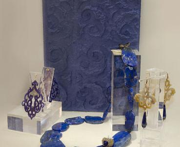 Album papier-mâché, lapis lazuli necklace, earrings plexiglass and silver, and lapis lazuli earrings made of horn.
